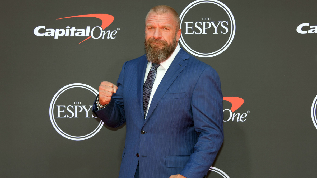 WWE personality Triple H arrives on the red carpet at Microsoft Theatre.