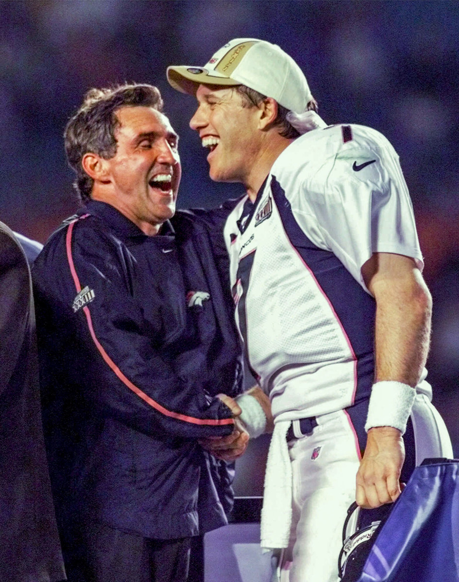 Mike Shanahan and John Elway celebrate after defeating the Falcons in Super Bowl XXXIII