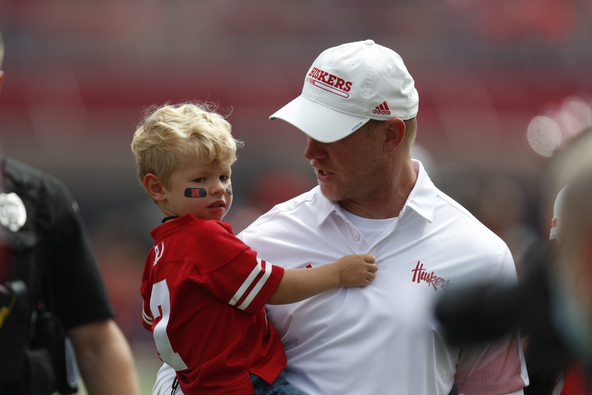 Sep 4, 2021; Lincoln, Nebraska, USA; Nebraska Cornhuskers head coach Scott Frost carries his son, RJ, off the field after defeating the Fordham Rams at Memorial Stadium. Mandatory Credit: Bruce Thorson-USA TODAY Sports