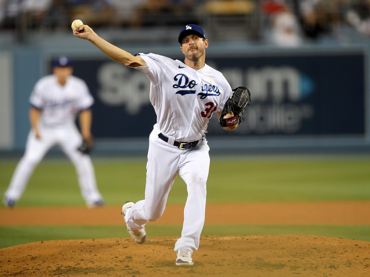 Sep 1, 2021; Los Angeles, California, USA;  Los Angeles Dodgers starting pitcher Max Scherzer (31) pitches in the third inning of the game against the Atlanta Braves at Dodger Stadium.
