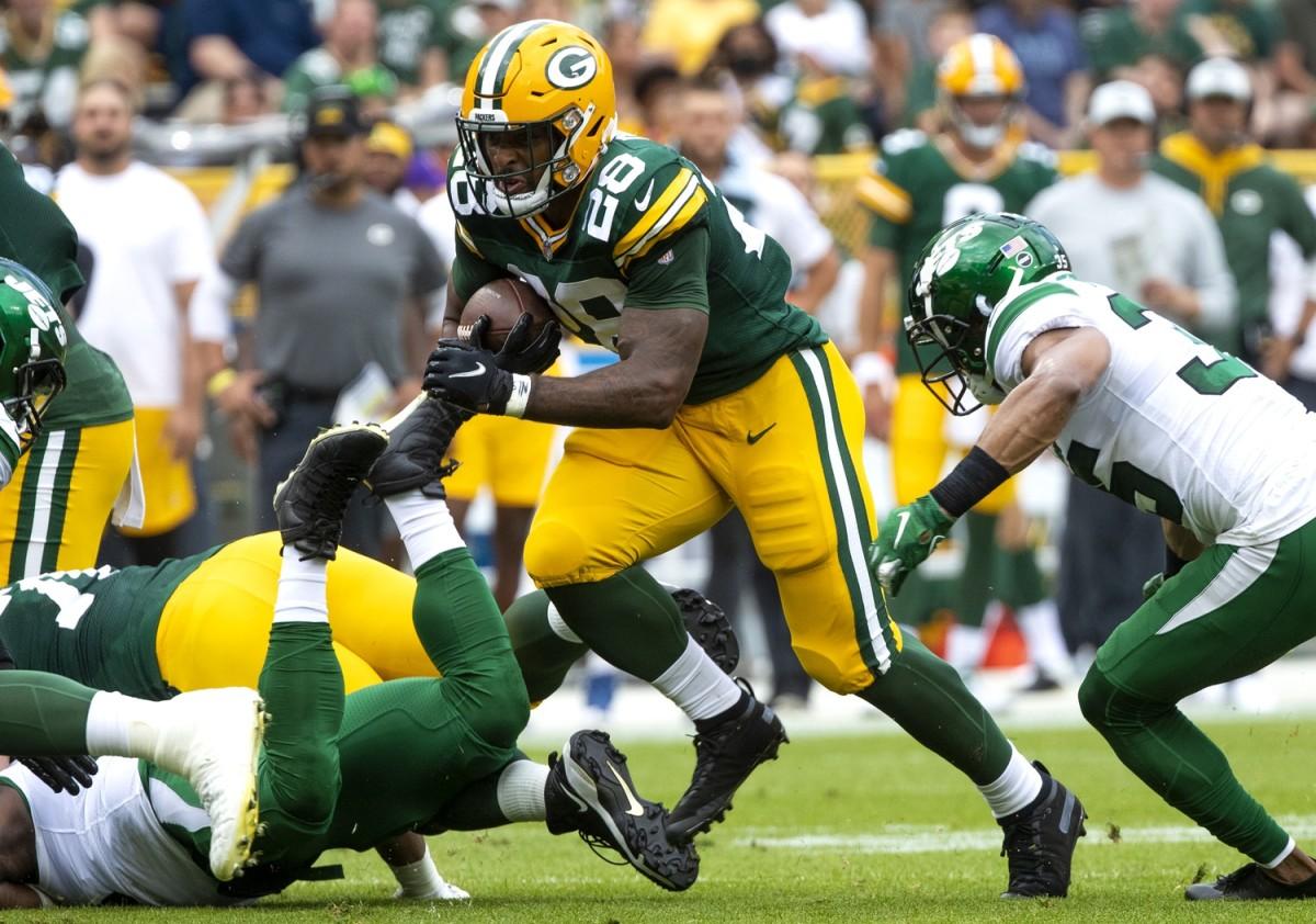 Green Bay Packers running back AJ Dillon (28) runs the ball against the New York Jets during a preseason game. Mandatory Credit: Samantha Madar/USA TODAY NETWORK-Wisconsin via USA TODAY NETWORK