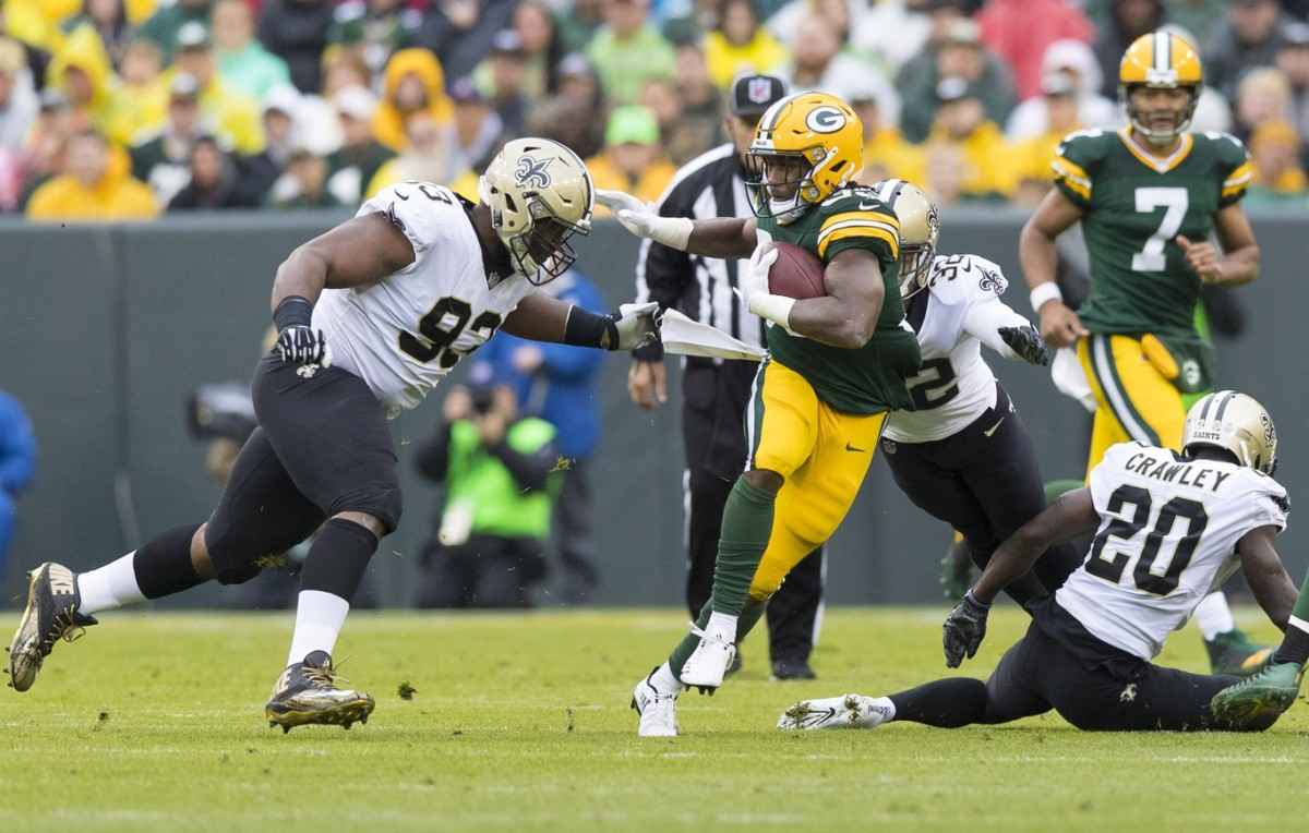 Green Bay Packers running back Aaron Jones (33) carries the ball against the New Orleans Saints. Mandatory Credit: Jeff Hanisch-USA TODAY Sports