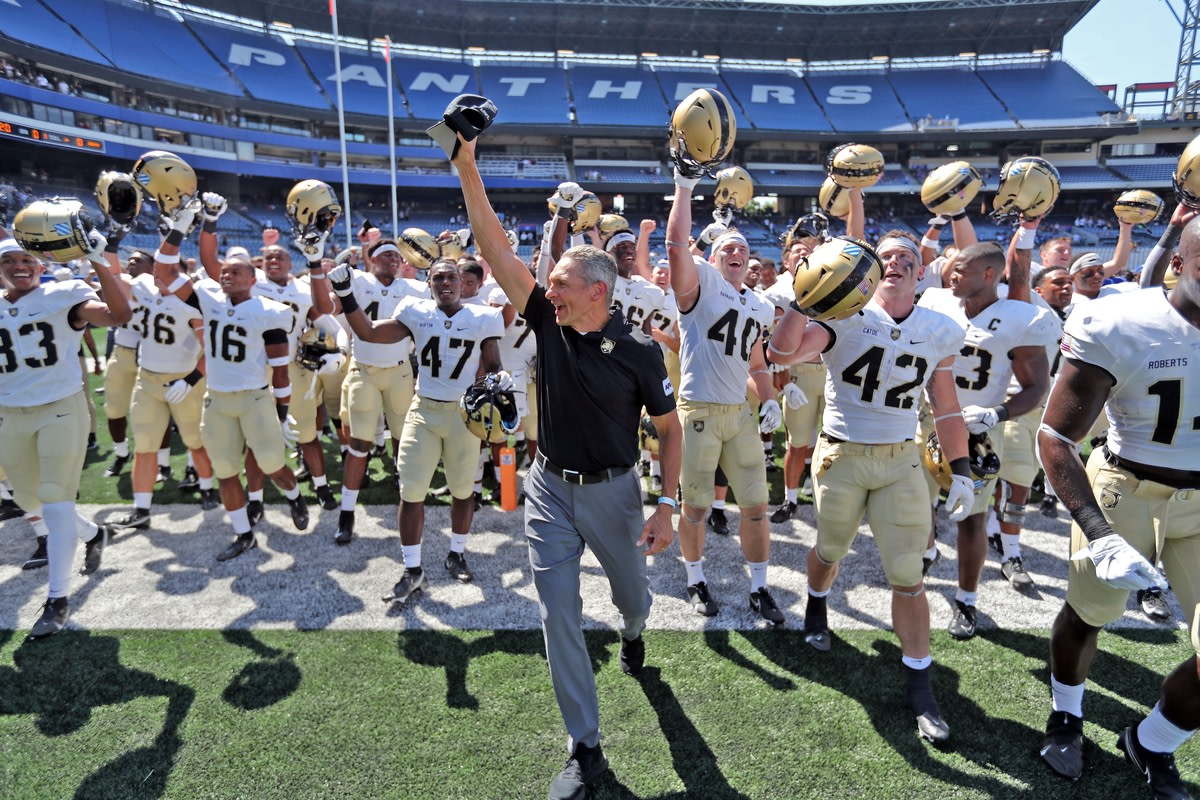Sep 4, 2021; Atlanta, Georgia, USA; Army Black Knights head coach Jeff Monken and his players celebrate a victory against the Georgia State Panthers at Center Parc Stadium. Mandatory Credit: Danny Wild-USA TODAY Sports