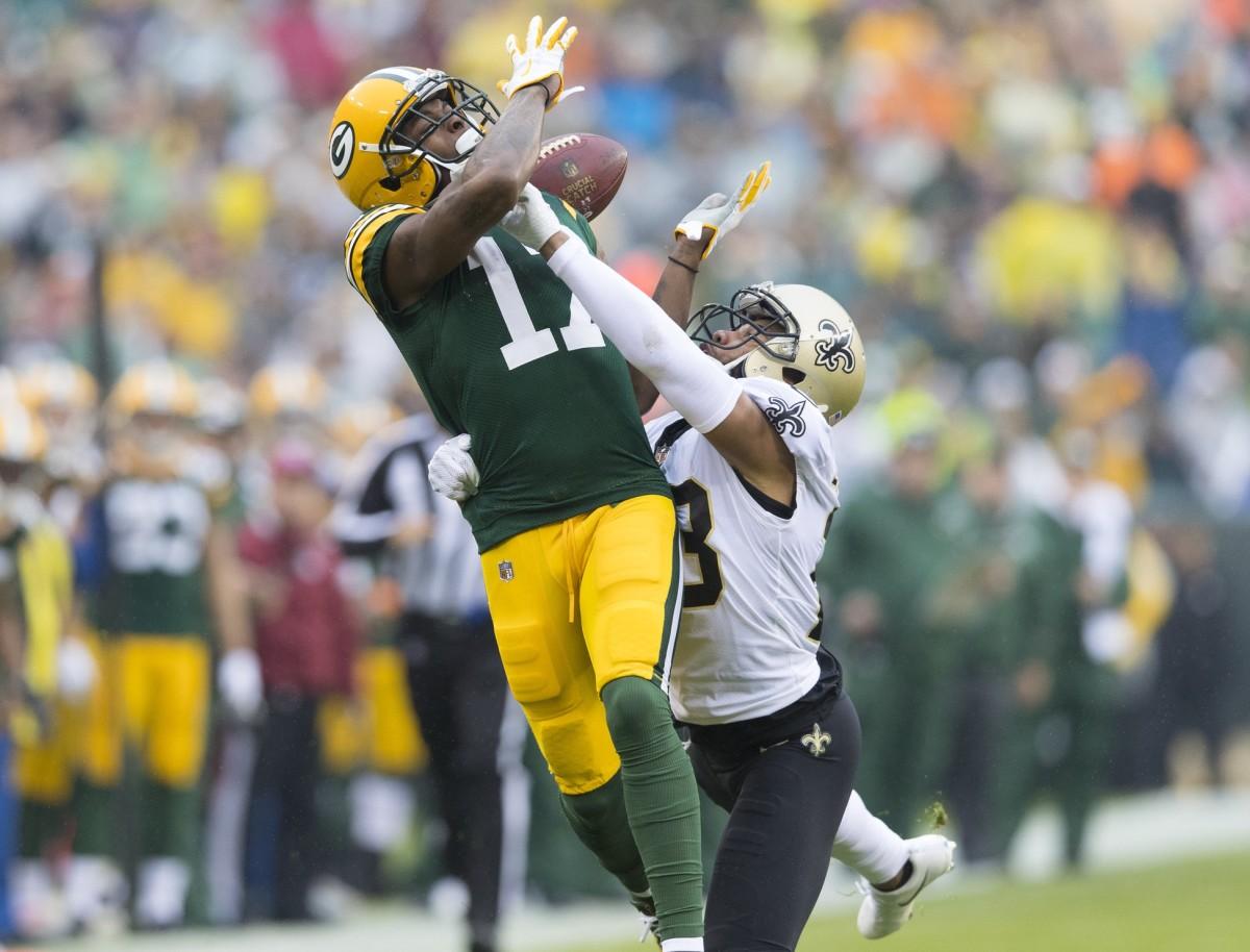 New Orleans Saints cornerback Marshon Lattimore (23) breaks up the pass intended for Green Bay receiver Davante Adams (17). Mandatory Credit: Jeff Hanisch-USA TODAY Sports