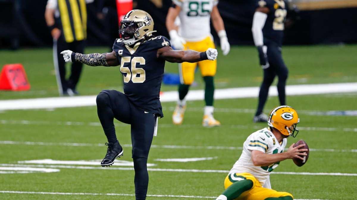 New Orleans Saints linebacker Demario Davis celebrates a sack of Packers quarterback Aaron Rodgers. Credit: neworleanssaints.com