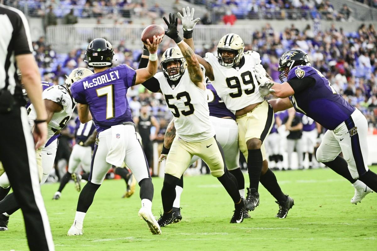 New Orleans Saints linebacker Zack Baun (53) and defensive tackle Shy Tuttle (99) pressure Ravens quarterback Trace McSorley (7). Mandatory Credit: Tommy Gilligan-USA TODAY Sports