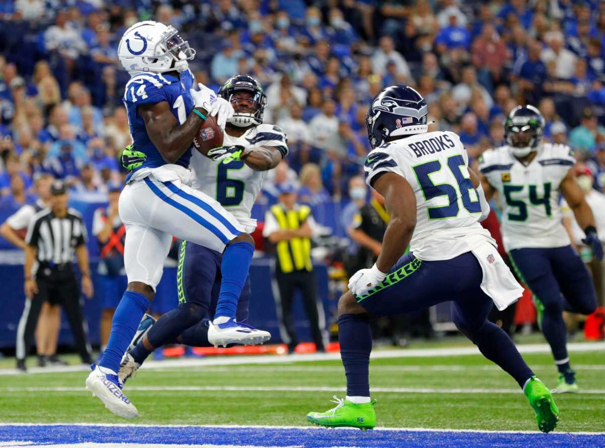 Indianapolis Colts wide receiver Zach Pascal (14) pulls in a pass in the end zone while being guarded by Seattle Seahawks strong safety Quandre Diggs (6) for the Colts' first touchdown Sunday, Sept. 12, 2021, during the regular season opener at Lucas Oil Stadium in Indianapolis.