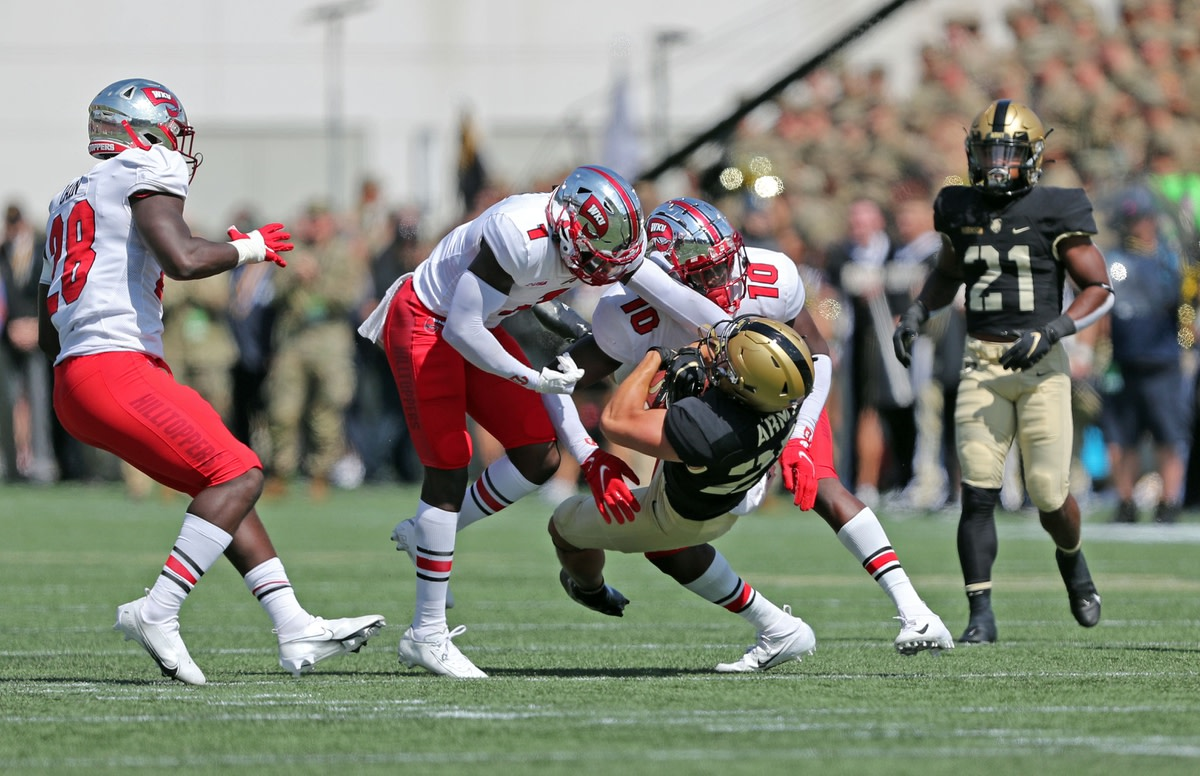 Sep 11, 2021; West Point, New York, USA; Army Black Knights wide receiver Cole Caterbone (29) is hit by Western Kentucky Hilltoppers defensive back Antwon Kincade (1) during the first half at Michie Stadium. Mandatory Credit: Danny Wild-USA TODAY Sports