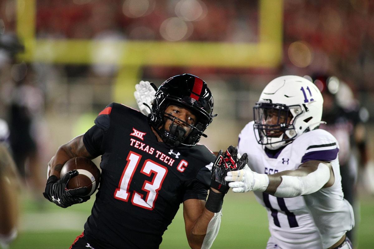 Sep 11, 2021; Lubbock, Texas, USA; Texas Tech Red Raiders wide receiver Erik Ezukanma (13) rushes against Stephen F. Austin Lumberjacks safety Jeremiah Davis (11) in the second half at Jones AT&T Stadium. Mandatory Credit: Michael C. Johnson-USA TODAY Sports