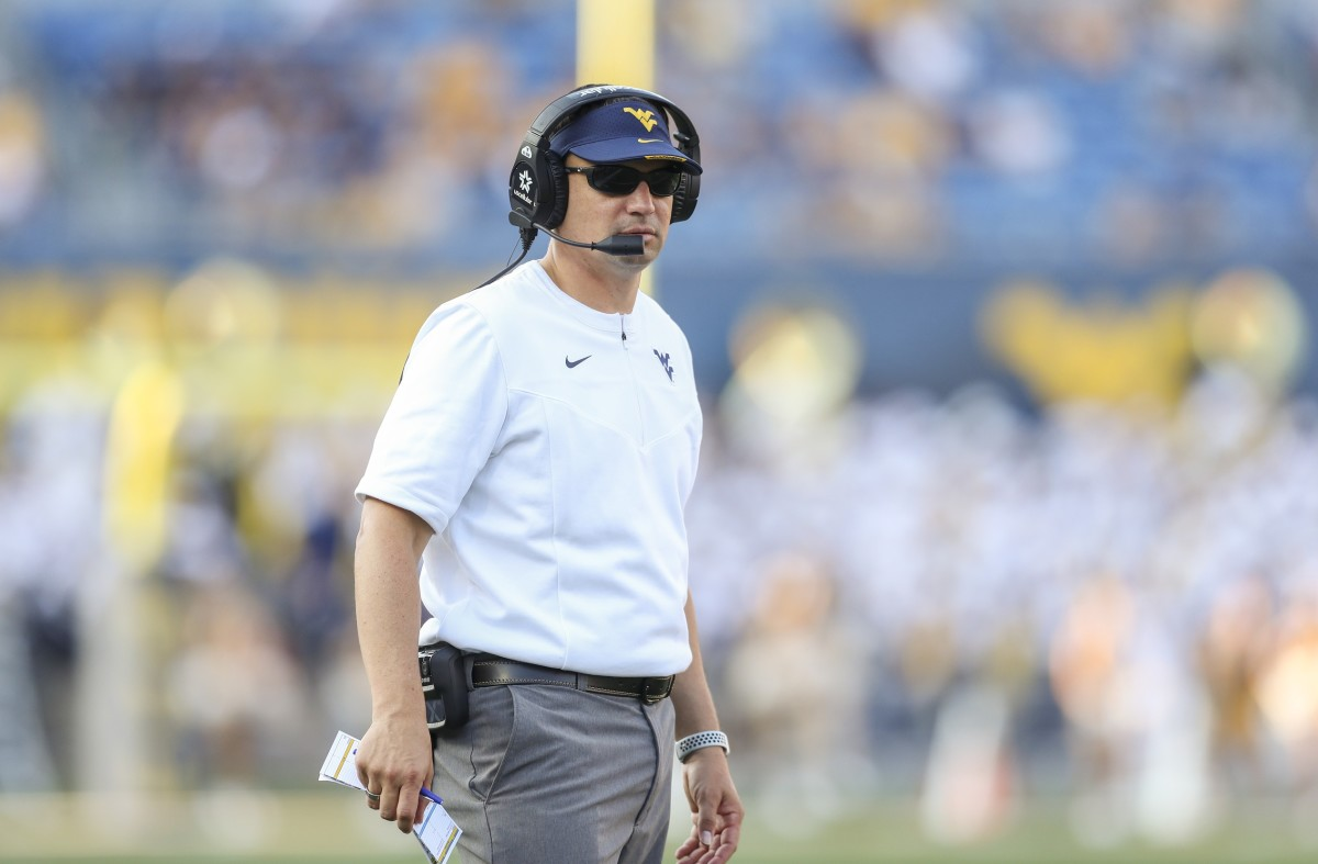 Sep 11, 2021; Morgantown, West Virginia, USA; West Virginia Mountaineers head coach Neal Brown looks on from the sideline during the second quarter against the Long Island Sharks at Mountaineer Field at Milan Puskar Stadium.