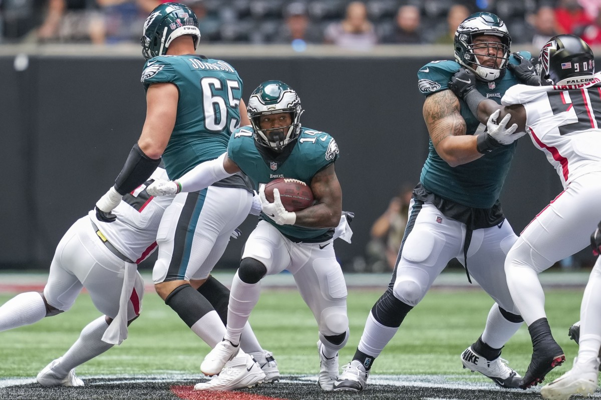 The Eagles' offenisve line opens a hole for Kenny Gainwell to slide through in win over the Falcons on Sept. 12, 2021