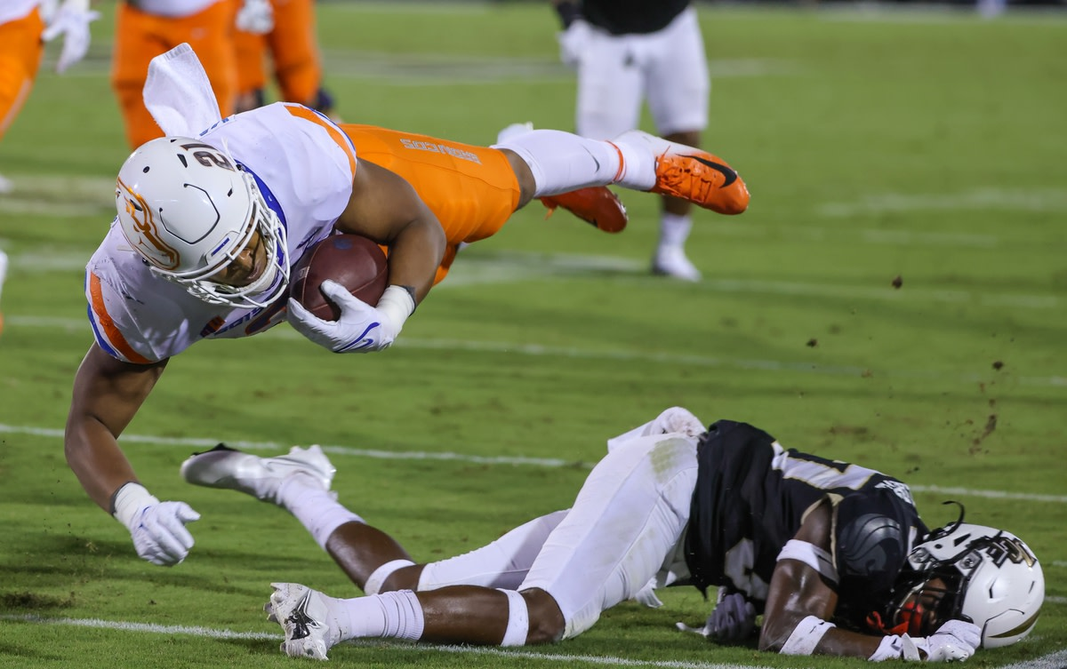Sep 2, 2021; Orlando, Florida, USA; Boise State Broncos running back Andrew Van Buren (21) dives over UCF Knights defensive back Quadric Bullard (37) during the first quarter at Bounce House. Mandatory Credit: Mike Watters-USA TODAY Sports