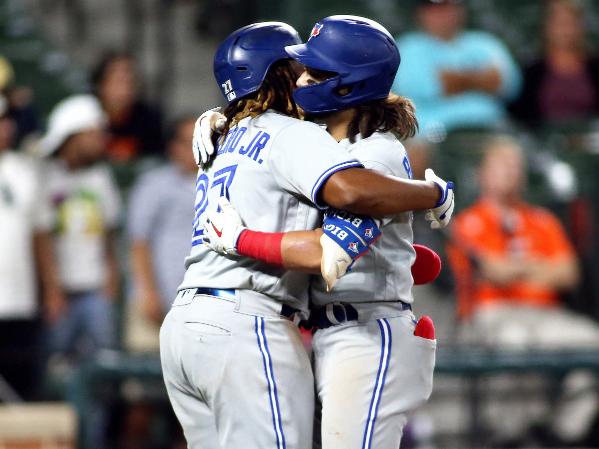 Sept. 11, 2021; Baltimore, Maryland, USA; Toronto Blue Jays designated hitter Vladimir Guerrero Jr. (27) celebrates with Toronto Blue Jays shortstop Bo Bichette (11) during the seventh inning against the Baltimore Orioles at Oriole Park at Camden Yards.