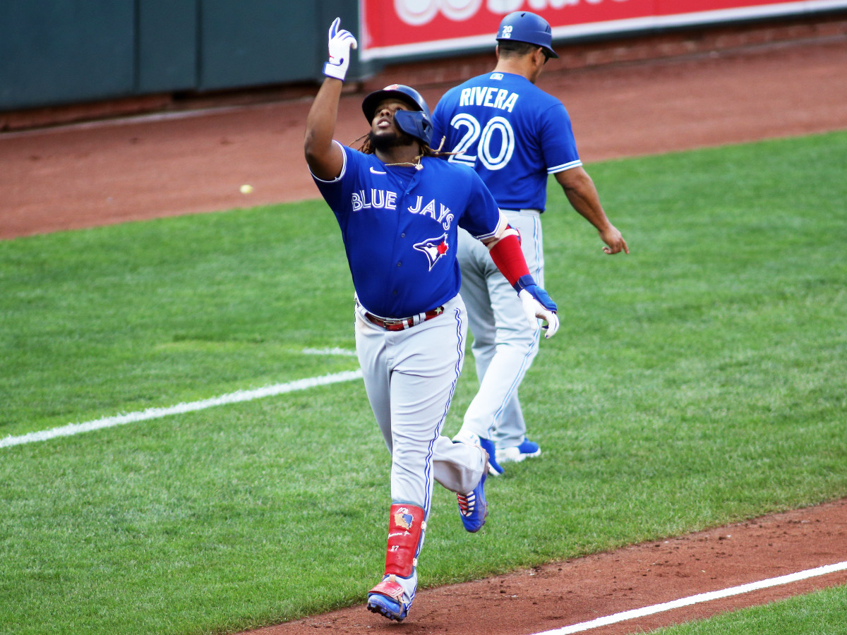 Sept. 11, 2021; Baltimore, Maryland, USA; Toronto Blue Jays designated hitter Vladimir Guerrero Jr. (27) hits a home run during the third inning against the Baltimore Orioles at Oriole Park at Camden Yards.