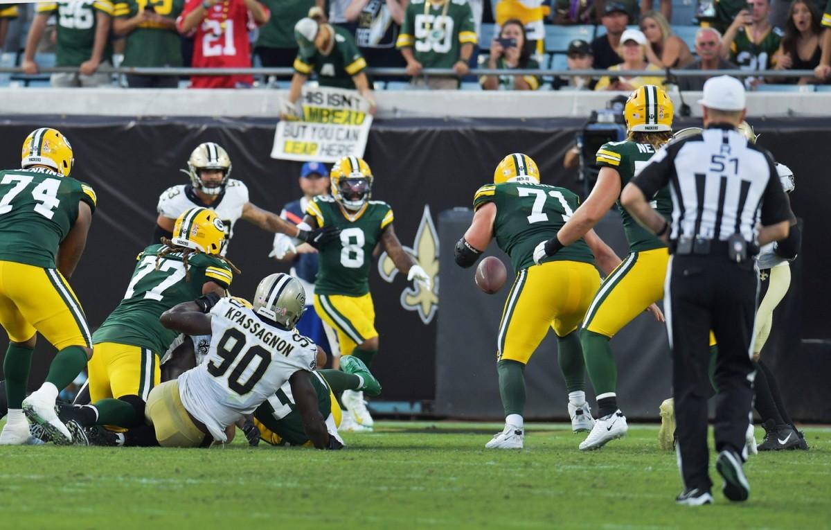 Saints defensive end Tanoh Kpassagnon (90) causes a fourth quarter fumble by Green Bay Packers quarterback Jordan Love (10).© Bob Self/Florida Times-Union via Imagn Content Services, LLC