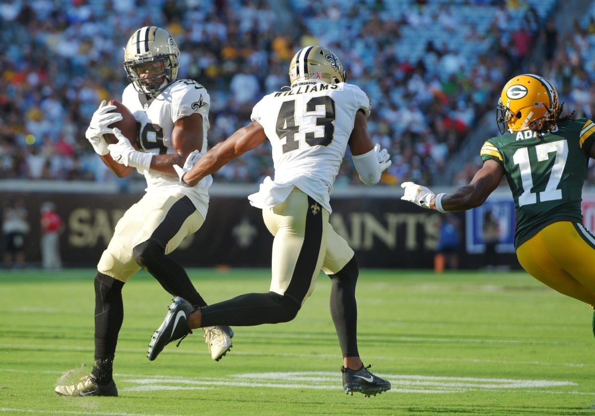 New Orleans Saints cornerback Paulson Adebo (29) intercepts a pass from Packers quarterback Aaron Rodgers (12) during early third quarter action.© Bob Self/Florida Times-Union via Imagn Content Services, LLC