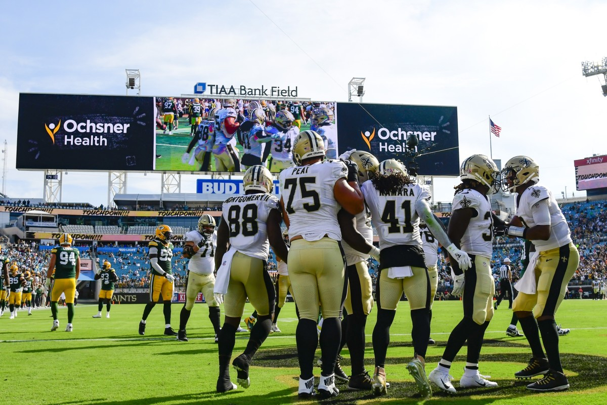 Sep 12, 2021; Jacksonville, Florida, USA; Saints running back Alvin Kamara (41) reacts after scoring a second quarter touchdown against the Packers at TIAA Bank Field. Mandatory Credit: Tommy Gilligan-USA TODAY Sports