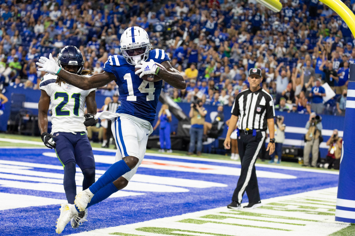 Sep 12, 2021; Indianapolis, Indiana, USA; Indianapolis Colts wide receiver Zach Pascal (14) catches a touchdown pass while Seattle Seahawks cornerback Tre Flowers (21) defends in the second half at Lucas Oil Stadium. Mandatory Credit: Trevor Ruszkowski-USA TODAY Sports