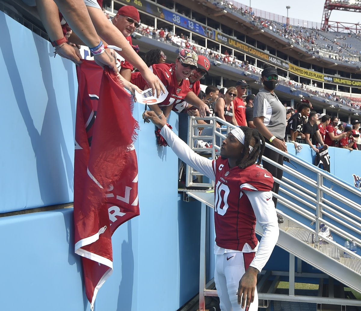 Sep 12, 2021; Nashville, Tennessee, USA; Arizona Cardinals wide receiver DeAndre Hopkins (10) signs a autograph for a fan during the second half at Nissan Stadium. Mandatory Credit: Steve Roberts-USA TODAY Sports