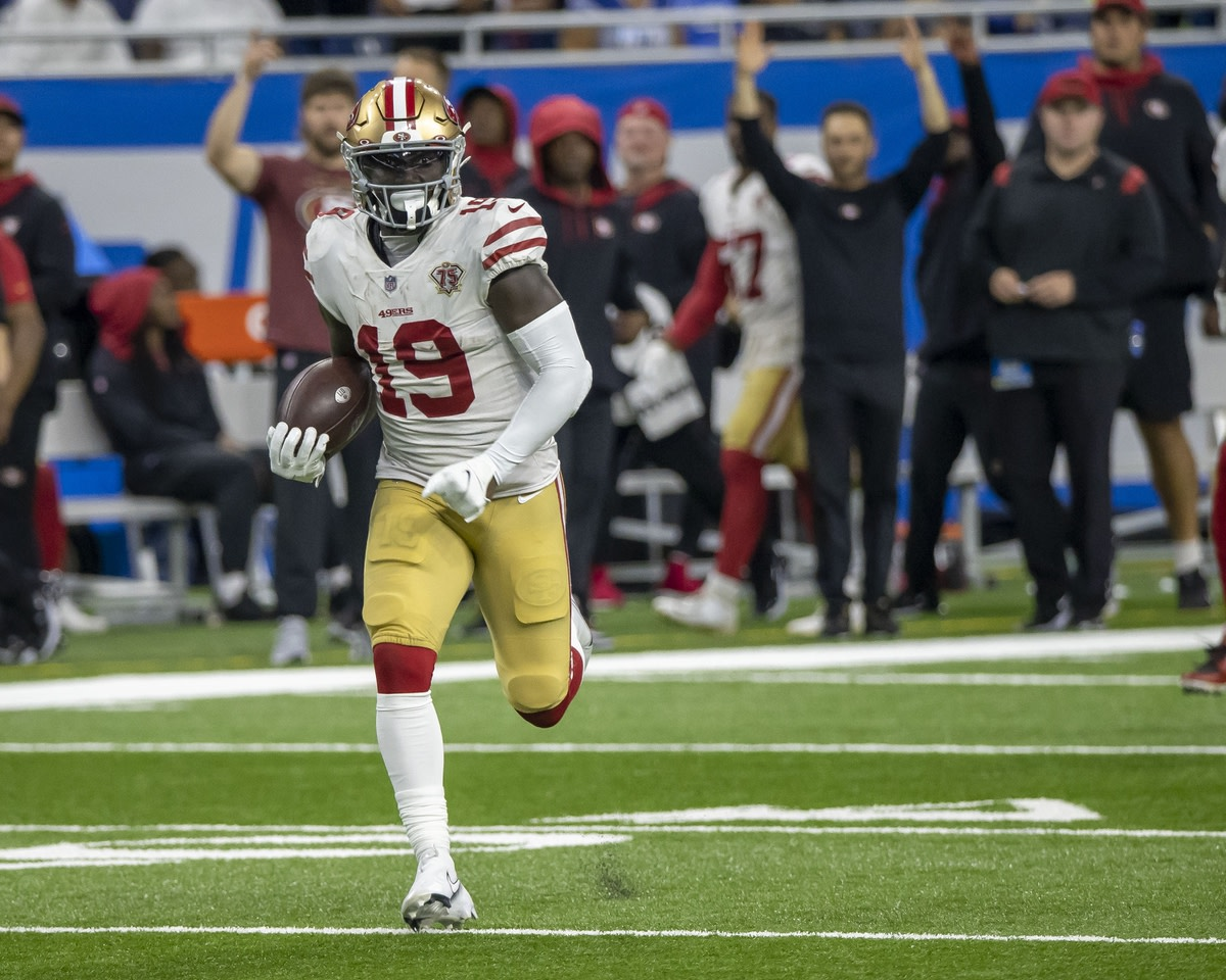 Sep 12, 2021; Detroit, Michigan, USA; San Francisco 49ers wide receiver Deebo Samuel (19) runs for a touchdown against the Detroit Lions in the third quarter at Ford Field. Mandatory Credit: David Reginek-USA TODAY Sports