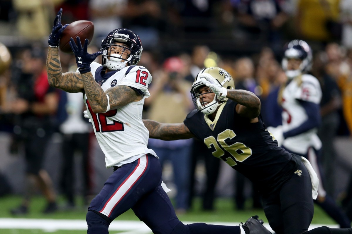 Houston Texans wide receiver Kenny Stills (12) makes a touchdown catch against New Orleans Saints cornerback P.J. Williams (26). Mandatory Credit: Chuck Cook-USA TODAY