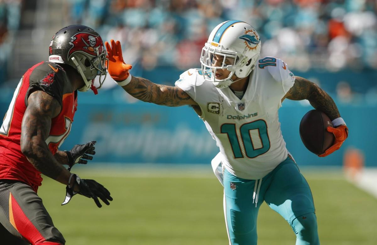 Miami Dolphins wide receiver Kenny Stills (10) stiff arms Tampa Bay cornerback Ryan Smith (29). Mandatory Credit: Reinhold Matay-USA TODAY