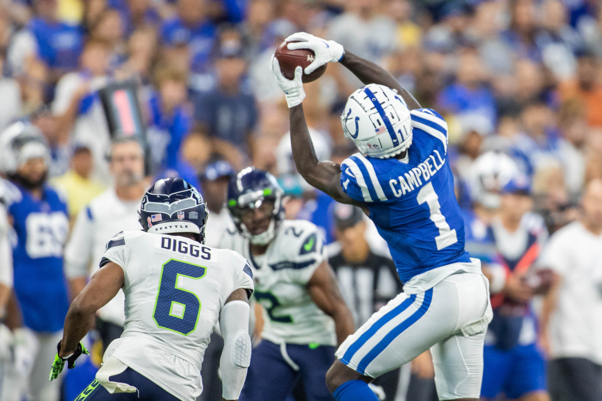 Sep 12, 2021; Indianapolis, Indiana, USA; Indianapolis Colts wide receiver Parris Campbell (1) catches the ball while Seattle Seahawks strong safety Quandre Diggs (6) defends in the second quarter at Lucas Oil Stadium. Mandatory Credit: Trevor Ruszkowski-USA TODAY Sports