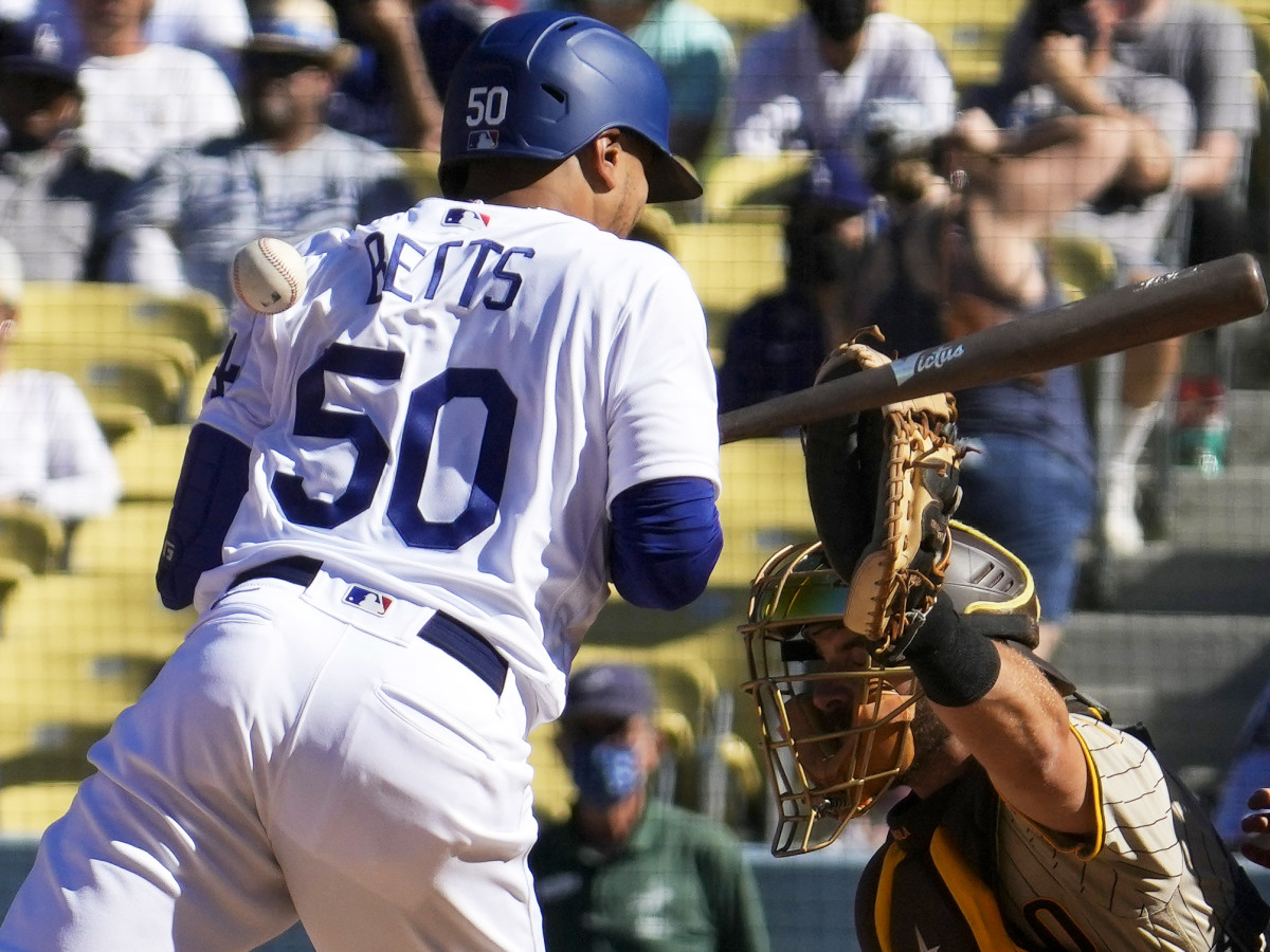 Sep 12, 2021; Los Angeles, California, USA; Los Angeles Dodgers center fielder Mookie Betts (50) gets hit in the back by a pitch from San Diego Padres reliever Austin Adams (not pictured) in the eighth inning at Dodger Stadium.