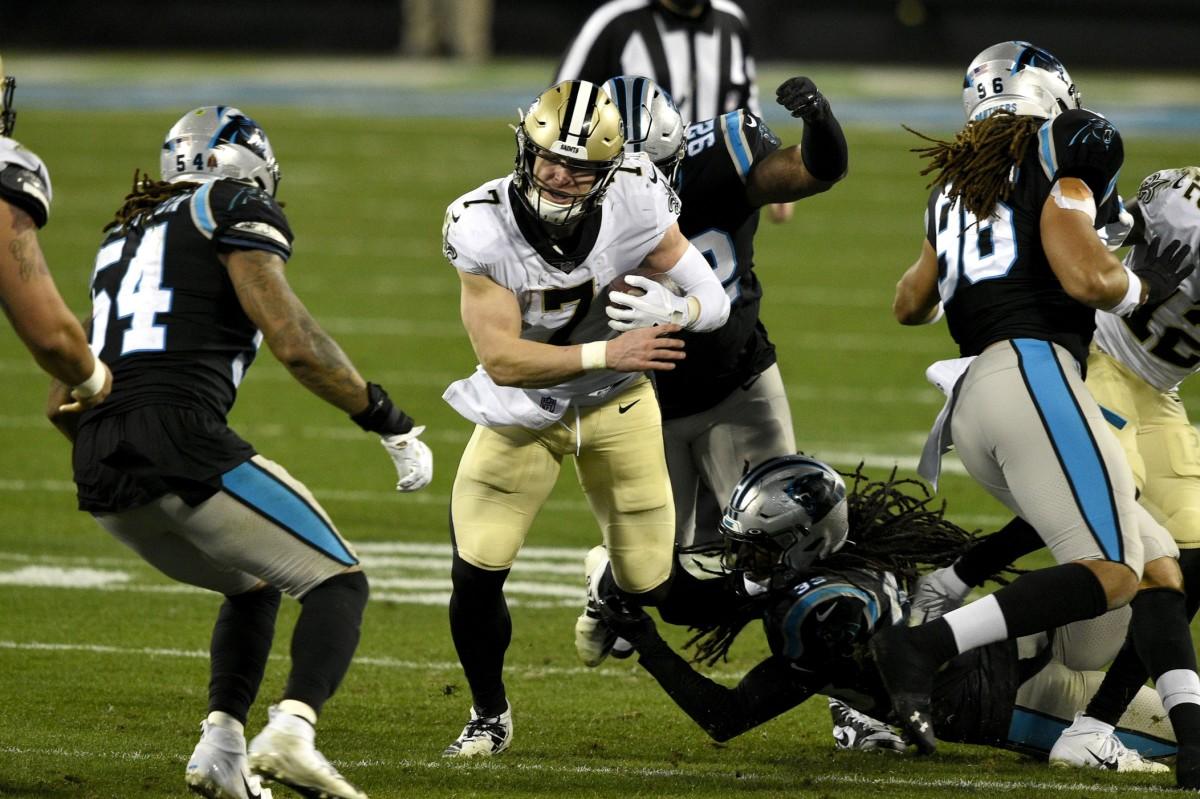 New Orleans Saints quarterback Taysom Hill (7) runs as Carolina Panthers outside linebacker Shaq Thompson (54) defends. Mandatory Credit: Bob Donnan-USA TODAY Sports
