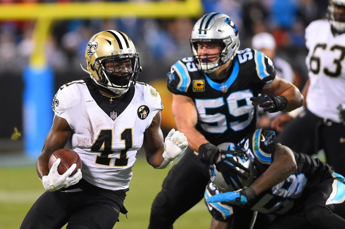 New Orleans Saints running back Alvin Kamara (41) runs the ball against the Carolina Panthers. Mandatory Credit: Bob Donnan-USA TODAY Sports