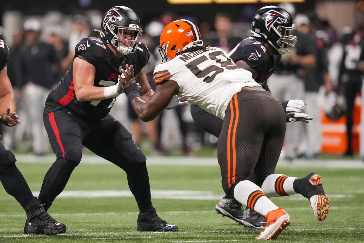 Aug 29, 2021; Atlanta, Georgia, USA; Atlanta Falcons offensive tackle Jalen Mayfield (77) blocks against Cleveland Browns defensive tackle Malik McDowell (58) during the first half at Mercedes-Benz Stadium. Mandatory Credit: Dale Zanine-USA TODAY Sports