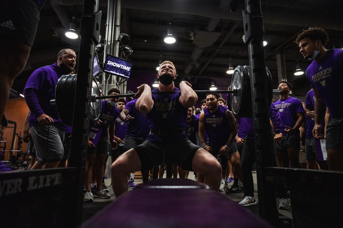Cooper McDonald lifts a huge amount of weight, encouraged by his teammates.