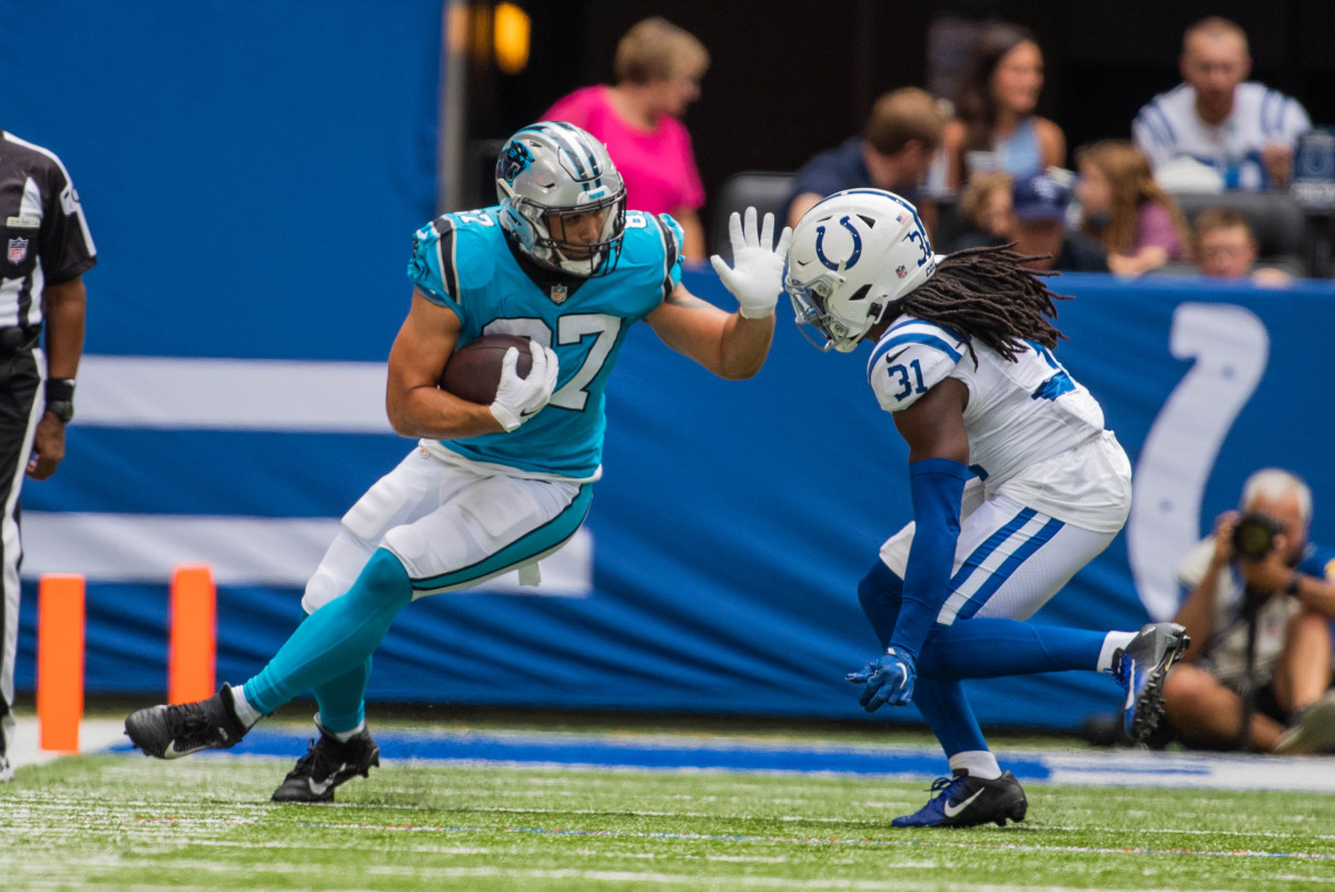 Aug 15, 2021; Indianapolis, Indiana, USA; Carolina Panthers tight end Giovanni Ricci (87) runs with the ball while Indianapolis Colts safety Shawn Davis (31) defends in the second half at Lucas Oil Stadium.