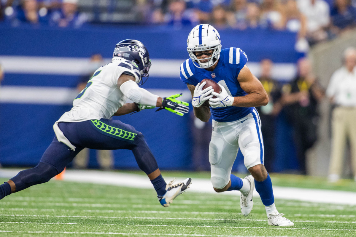 Sep 12, 2021; Indianapolis, Indiana, USA; Indianapolis Colts wide receiver Michael Pittman (11) catches the ball while Seattle Seahawks strong safety Quandre Diggs (6) defends in the second quarter at Lucas Oil Stadium.