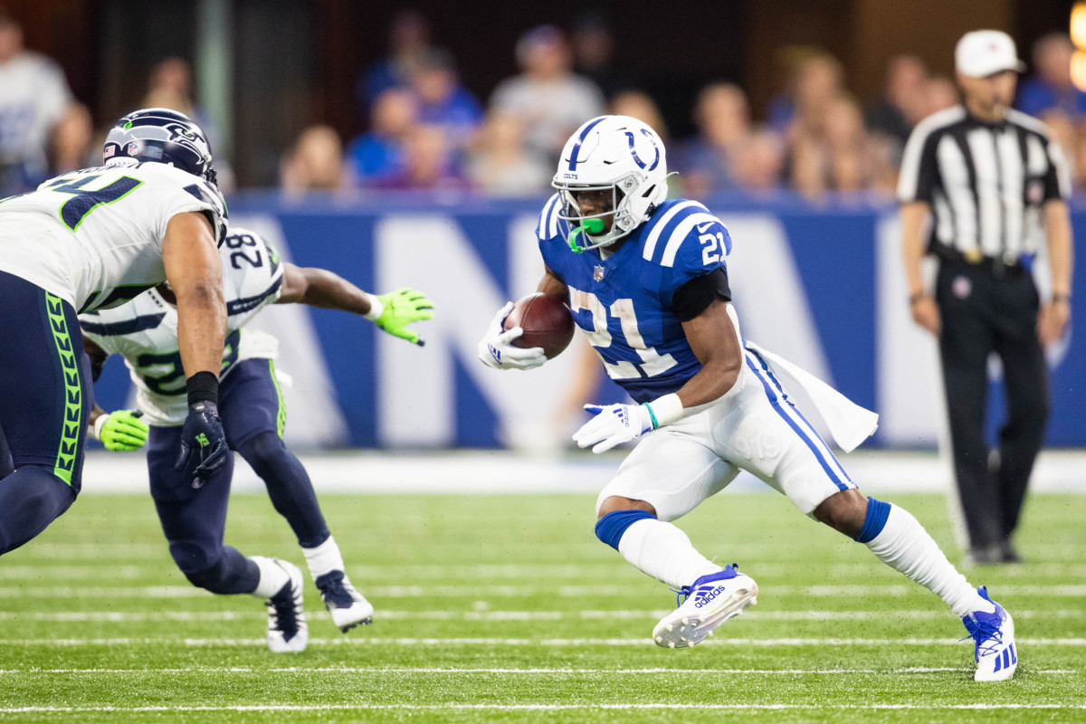 Sep 12, 2021; Indianapolis, Indiana, USA; Indianapolis Colts running back Nyheim Hines (21) runs the ball in the second half against the Seattle Seahawks at Lucas Oil Stadium.