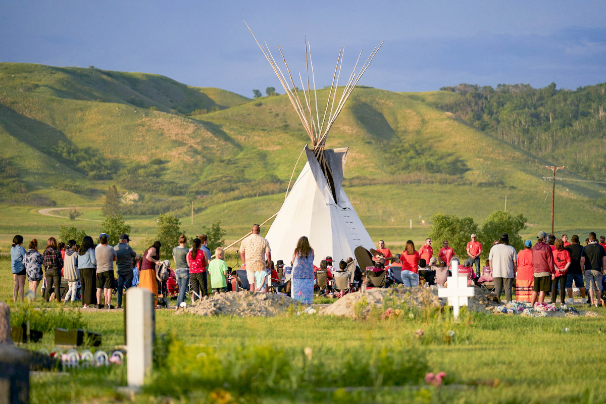 A June vigilon the Cowessess First Nation reservation, in Saskatchewan, near anotherunmarked grave site.