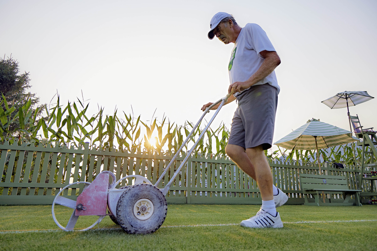 Mark Kuhn spends around 12 hours a week maintaining the grass tennis court in his side yard.