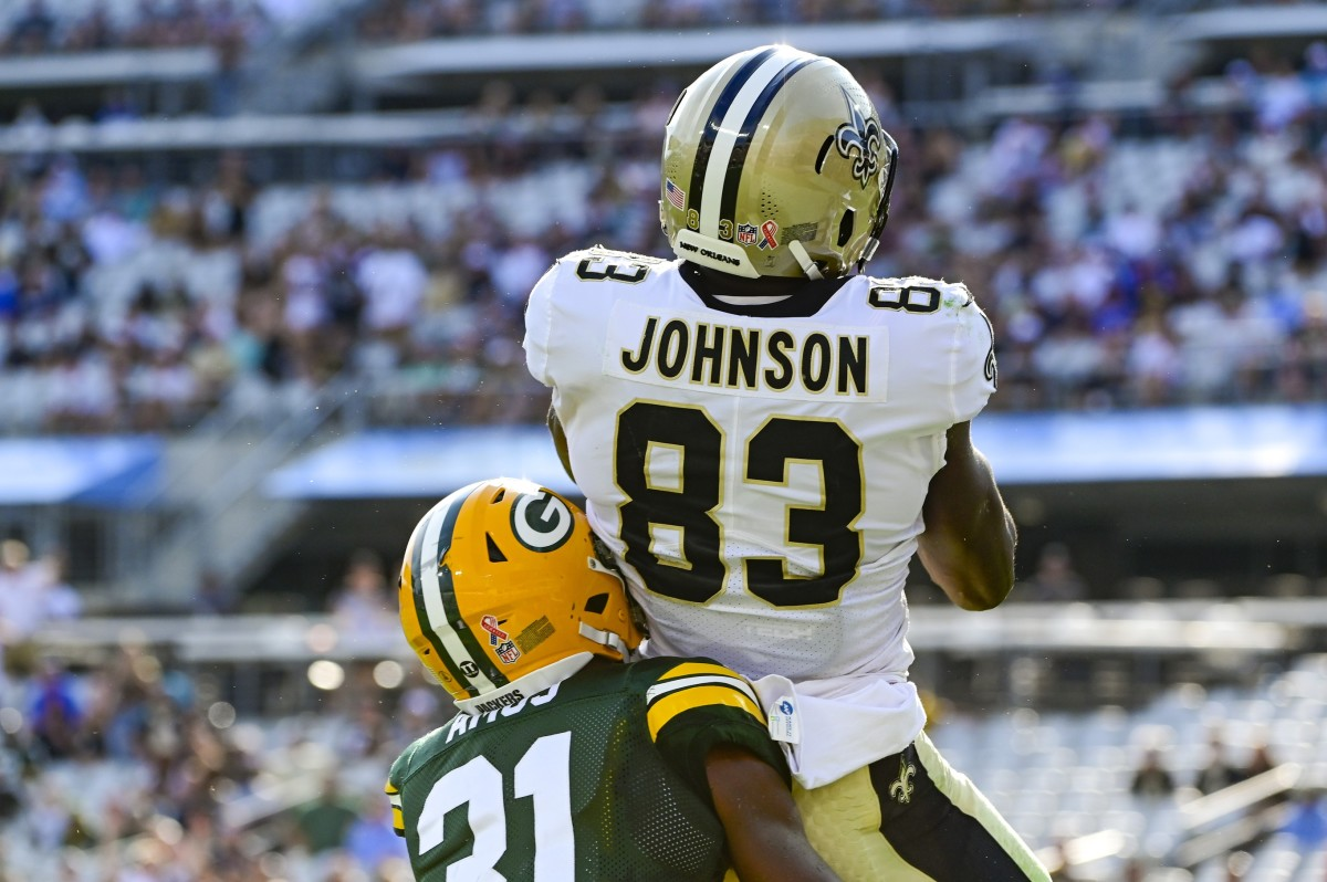 New Orleans Saints tight end Juwan Johnson (83) catches a touchdown Green Bay safety Adrian Amos (31). Mandatory Credit: Tommy Gilligan-USA TODAY Sports
