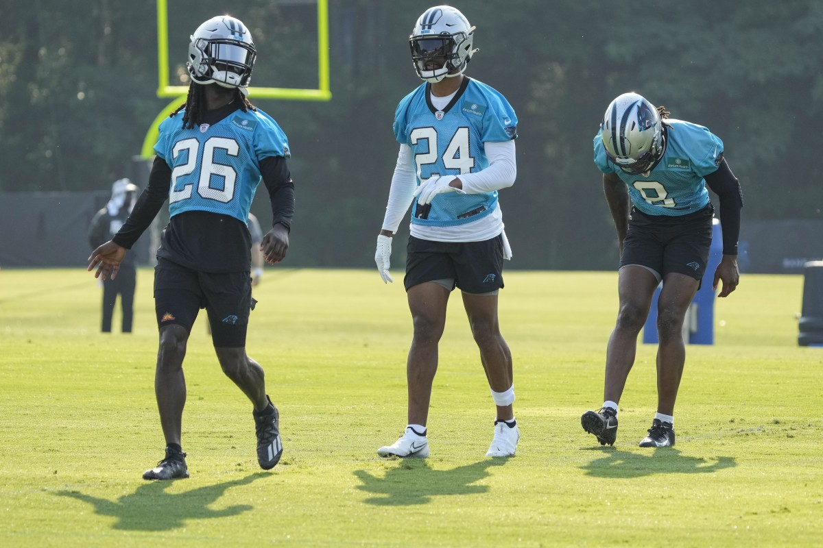 Carolina Panthers cornerback Donte Jackson (26) talks with A.J. Bouye (24) and Jaycee Horn (8) during the Training Camp. Mandatory Credit: Jim Dedmon-USA TODAY Sports