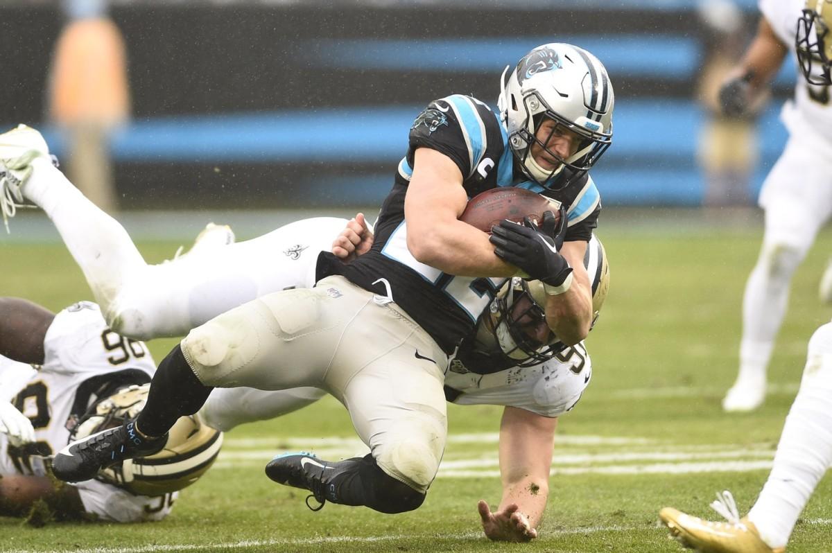 Carolina Panthers running back Christian McCaffrey (22) is tacked by New Orleans Saints defensive ends Carl Granderson (96) and Trey Hendrickson (91). Mandatory Credit: Bob Donnan-USA TODAY Sports