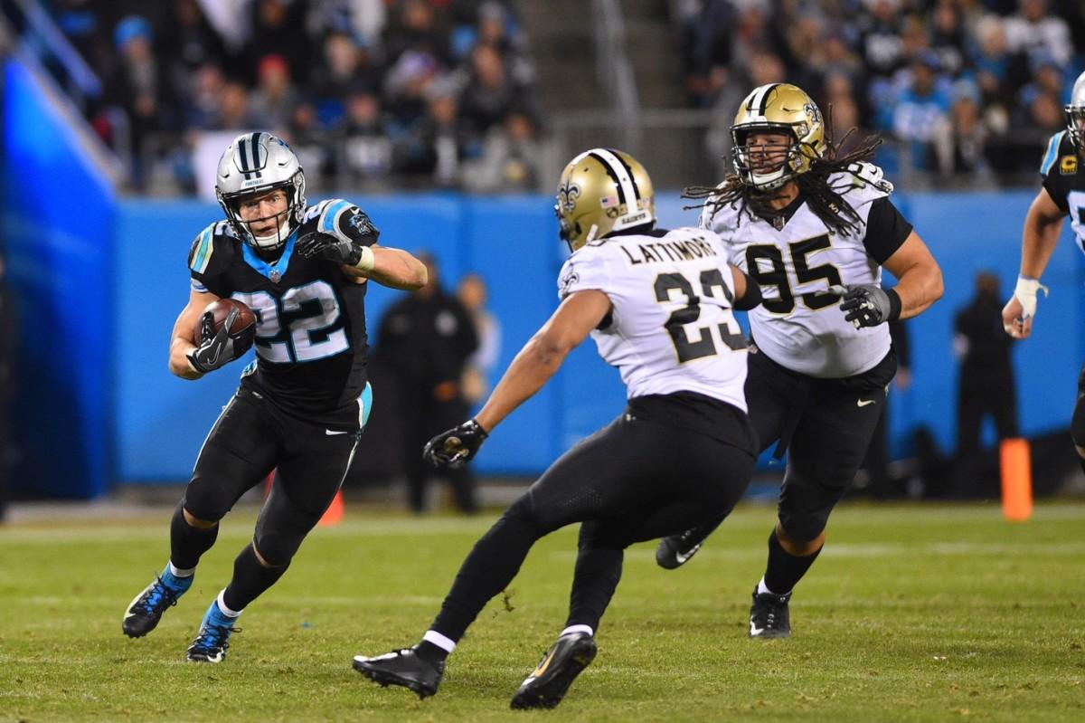 Carolina Panthers running back Christian McCaffrey (22) runs as New Orleans Saints cornerback Marshon Lattimore (23) defends. Mandatory Credit: Bob Donnan-USA TODAY Sports
