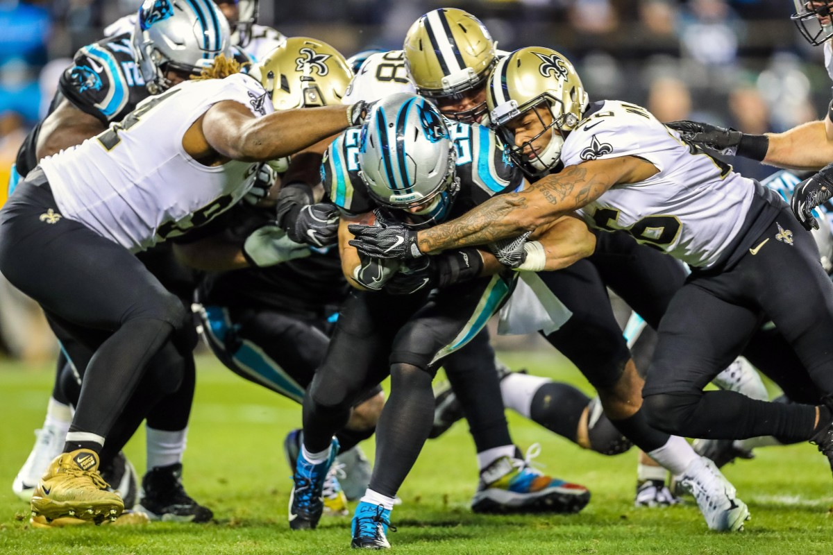 Carolina running back Christian McCaffrey (22) is wrapped up by the New Orleans Saints defense. Mandatory Credit: Jim Dedmon-USA TODAY Sports