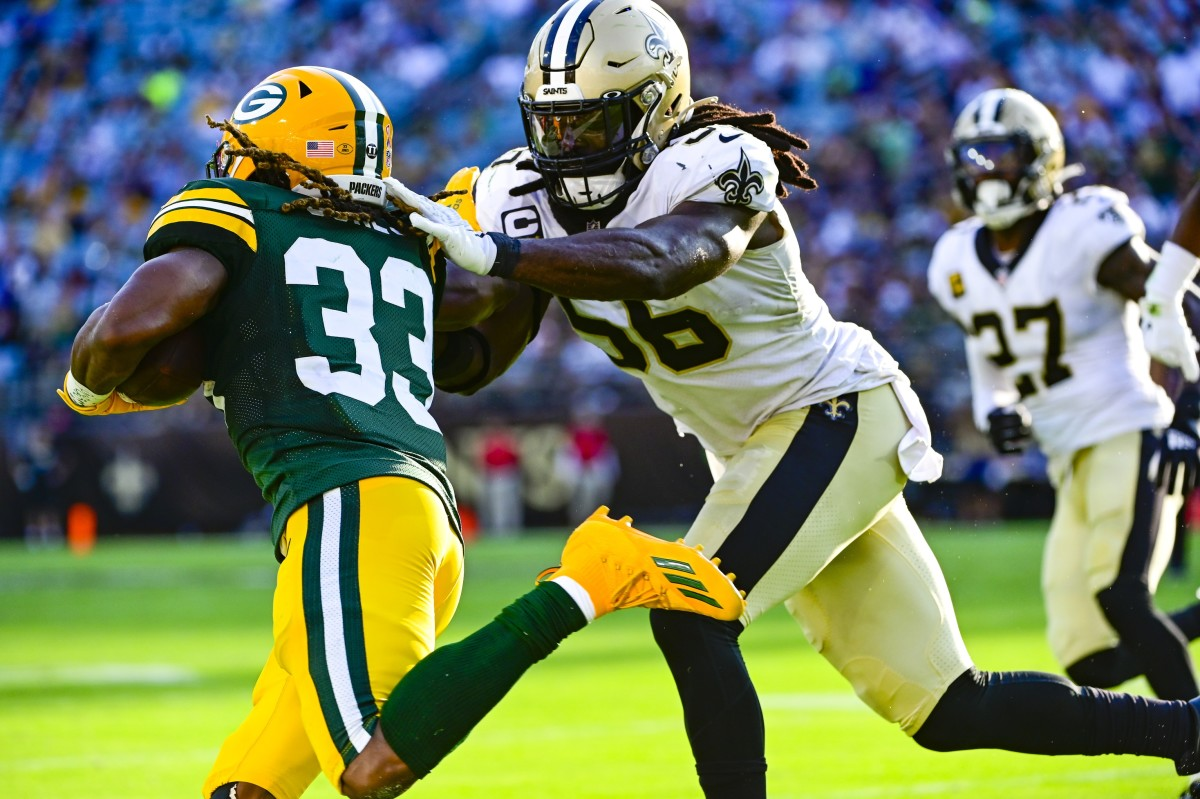 New Orleans Saints linebacker Demario Davis (56) drives Packers running back Aaron Jones (33) out of bounds. Mandatory Credit: Tommy Gilligan-USA TODAY