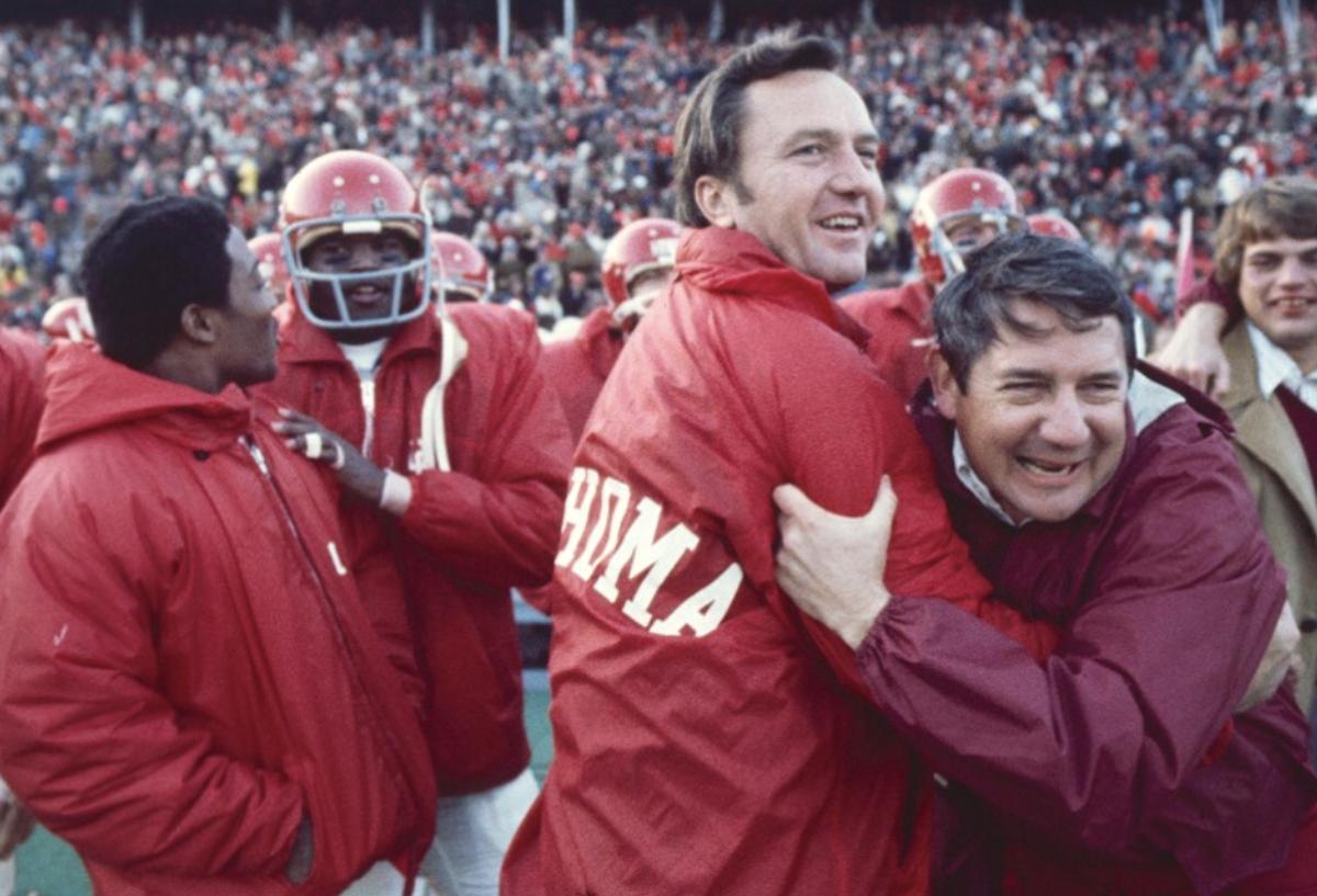 Chuck Fairbanks (center, after beating Nebraska in 1972)