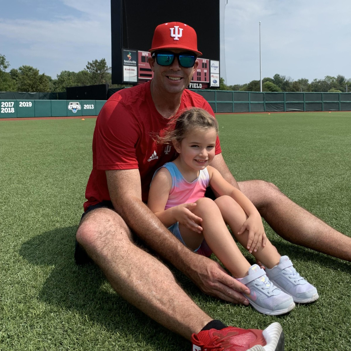 Indiana pitching coach Dustin Glant with his 4-year-old daughter Evelyn at Bart Kaufman Field.
