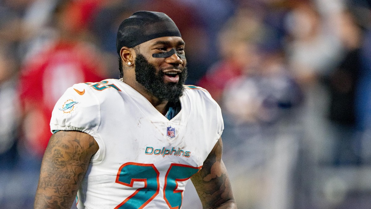 Xavien Howard smiles on the field during warmups before a Dolphins-Patriots season-opening game in 2021
