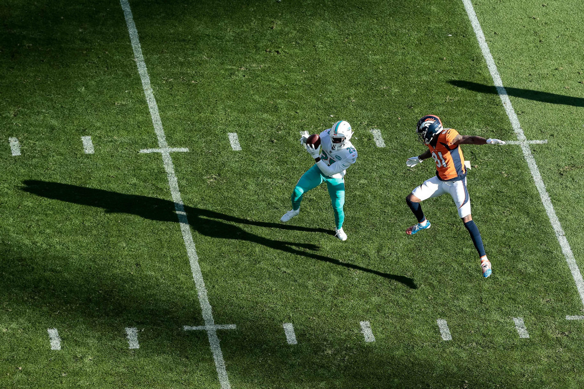 Xavien Howard steps in front of Broncos receiver Tim Patrick to intercept a pass during a 2020 game