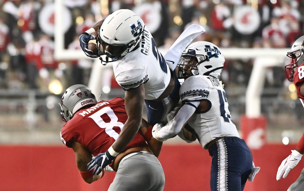 Sep 4, 2021; Pullman, Washington, USA; Utah State Aggies running back John Gentry (2) is up ended by Washington State Cougars defensive back Armani Marsh (8) in the second half at Gesa Field at Martin Stadium. The Aggies26-23. Mandatory Credit: James Snook-USA TODAY Sports