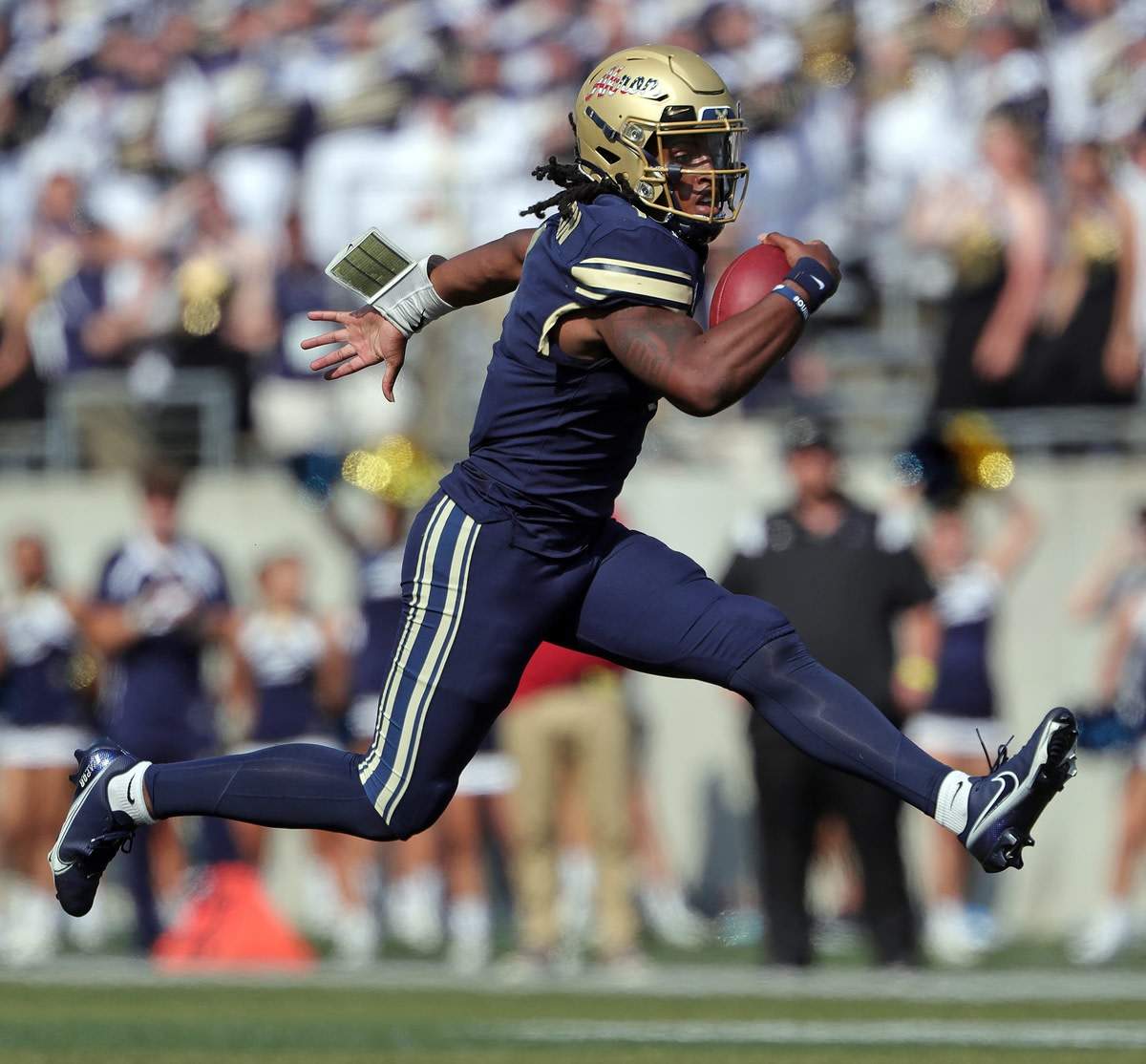 Akron Zips quarterback Kato Nelson (1) rushes for yards during the first half of an NCAA football game against the Temple Owls at InfoCision Stadium, Tuesday, Sept. 7, 2021, in Akron, Ohio.  Zipsfb 2