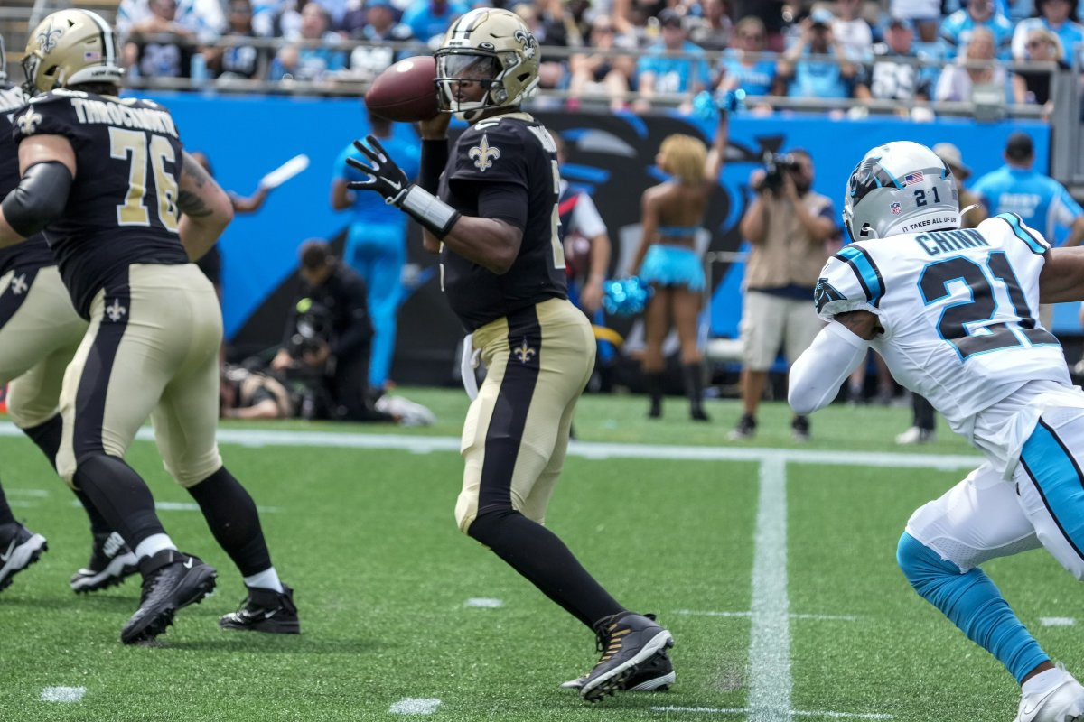 Sep 19, 2021; Charlotte, North Carolina, USA; New Orleans Saints quarterback Jameis Winston (2) back to pass as Carolina Panthers safety Jeremy Chinn (21) runs in for pressure during the first quarter at Bank of America Stadium. Mandatory Credit: Jim Dedmon-USA TODAY Sports
